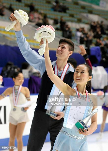 Gold medalists Sumire Suto and Francis BoudereauAudet wave to fans after at the medal ceremony for the Pair during day two of the 85th All Japan...
