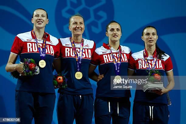 Gold medalists Tatiana Vidmer Mariia Cherepanova Tatiana Petrushina and Anna Leshkovtseva of Russia stand on the podium during the medal ceremony for...