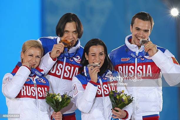 Gold medalists Tatiana Volosozhar and Maxim Trankov of Russia and silver medalists Ksenia Stolbova and Fedor Klimov of Russia celebrate during the...