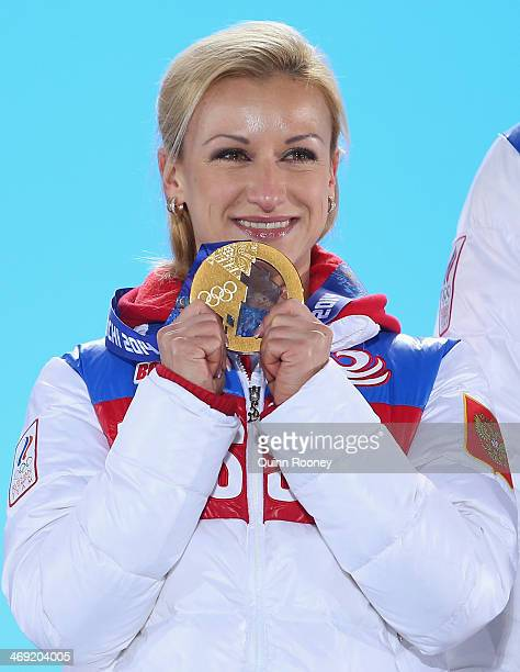 Gold medalists Tatiana Volosozhar of Russia celebrates during the medal ceremony for the Figure Skating Pairs Free Skating on day six of the Sochi...