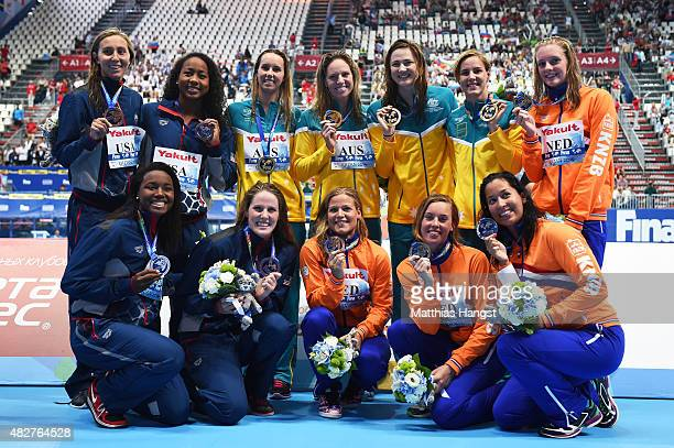 Gold medalists Team Australia pose silver medalist Team Netherlands and bronze medalists Team United States during the medal ceremony for the Women's...