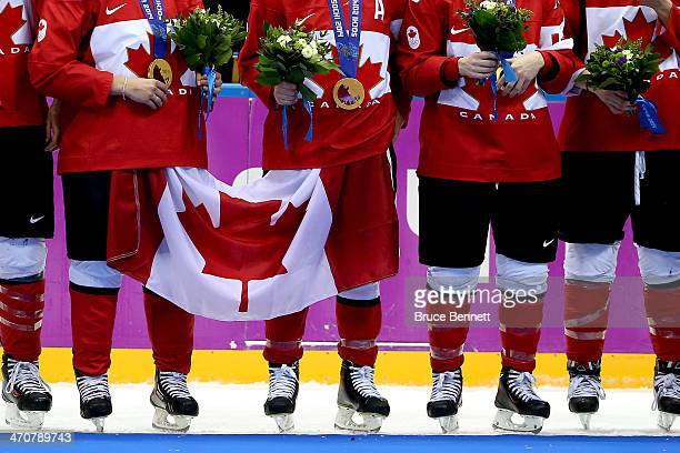 Gold medalists Team Canada celebrate during the medal ceremony after defeating the United States 3-2 in overtime during the Ice Hockey Women's Gold...