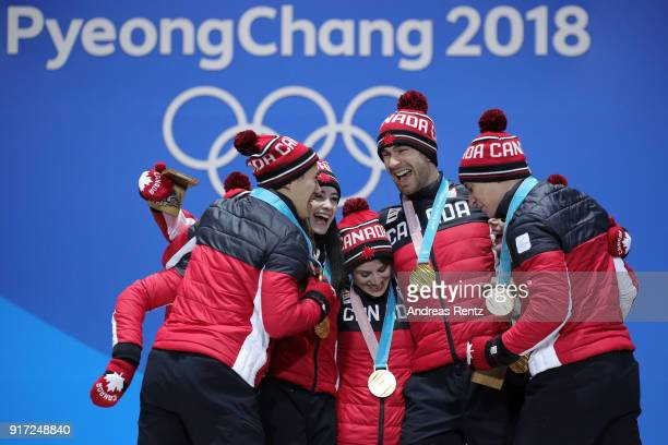 Gold medalists Team Canada celebrate during the medal ceremony after the Figure Skating Team Event at Medal Plaza on February 12, 2018 in...