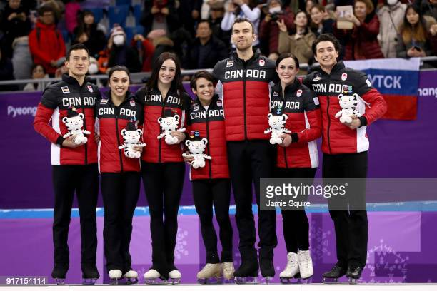 Gold medalists Team Canada celebrate on the podium during the victory ceremony after the Figure Skating Team Event on day three of the PyeongChang...