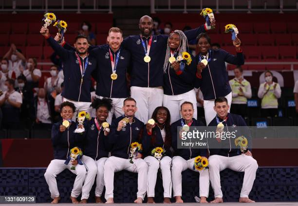 Gold Medalists Team France pose on the podium with their gold medals for Judo the Mixed Team Final on day eight of the Tokyo 2020 Olympic Games at...
