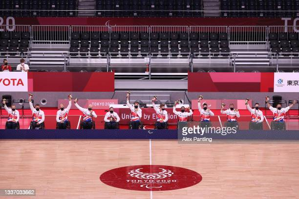 Gold medalists Team Great Britain react during the Mixed Wheelchair Rugby medal ceremony on day 5 of the Tokyo 2020 Paralympic Games at Yoyogi...