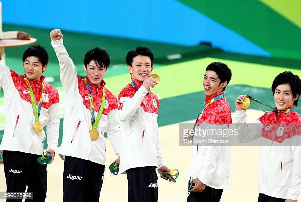 Gold medalists team Japan member Koji Yamamuro Kohei Uchimura Yusuke Tanaka Kenzo Shirai and Ryohei Kato of Japan celebrate on the podium at the...