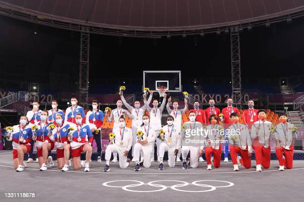Gold medalists Team Latvia and Team USA, Silver medalists Team ROC and Team ROC, and Bronze medalists Team Serbia and Team China pose with their...