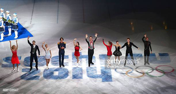 Gold medalists team Russia celebrate during the flower ceremony for the Team Figure Skating Overall during day two of the Sochi 2014 Winter Olympics...