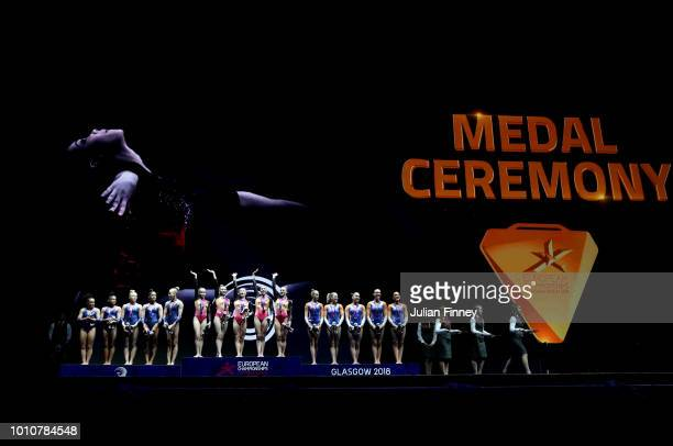 Gold medalists Team Russia pose with Silver medalists Team France and Bronze medalists Team Netherlands following the Women's Gymnastics Team Final...