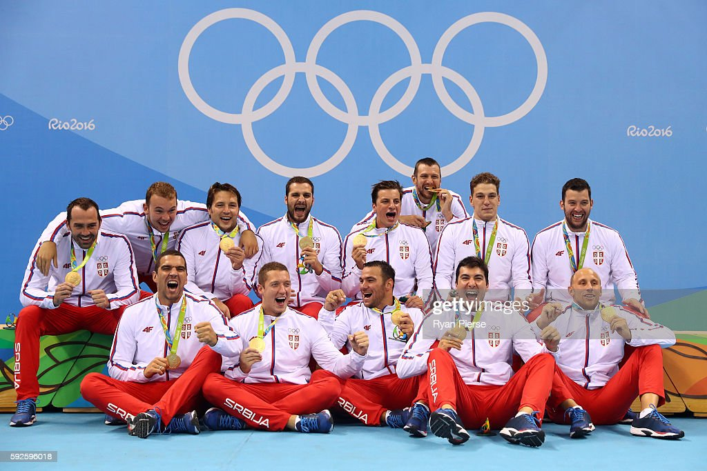 Gold medalists Team Serbia celebrate on the podium during the medal ceremony for the Men's Water Polo Gold Medal match between Croatia and Serbia on Day 15 of the Rio 2016 Olympic Games at the Olympic Aquatics Stadium on August 20, 2016 in Rio de Janeiro, Brazil.