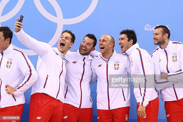 Gold medalists Team Serbia celebrate on the podium during the medal ceremony for the Men's Water Polo Gold Medal match between Croatia and Serbia on...