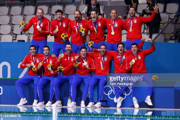 Gold medalists Team Serbia pose after the Men's Gold Medal match between Greece and Serbia on day sixteen of the Tokyo 2020 Olympic Games at Tatsumi...