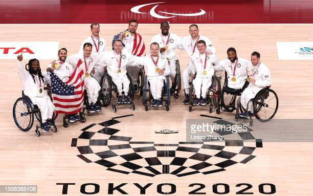 Gold medalists Team United States celebrate during the men's Wheelchair Basketball medal ceremony on day 12 of the Tokyo 2020 Paralympic Games at...