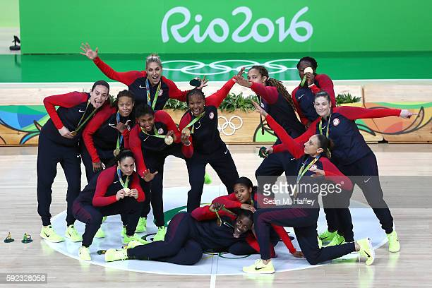 Gold medalists Team USA celebrate during the medal ceremony after the Women's Basketball competition on Day 15 of the Rio 2016 Olympic Games at...