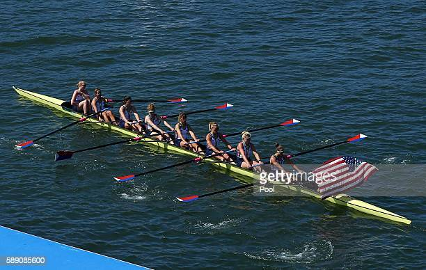 Gold medalists Team USA row away after the medal ceremony in the Women's Eight Finals at Lagoa Stadium August 13 2016 in Rio De Janeiro Brazil