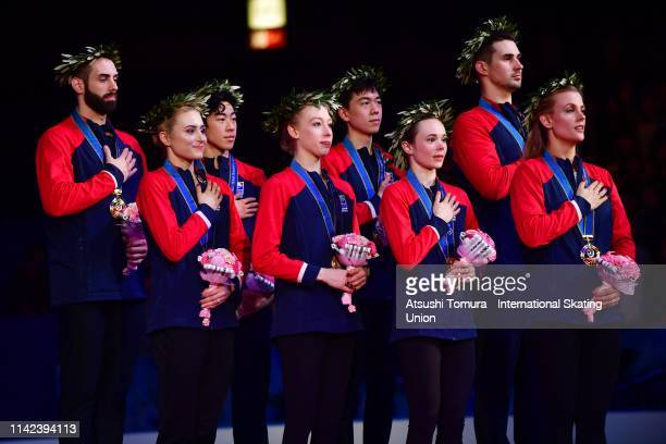 Gold medalists Team USA stand on the podium for the national anthem during the victory ceremony on day three of the ISU Team Trophy at Marine Messe...