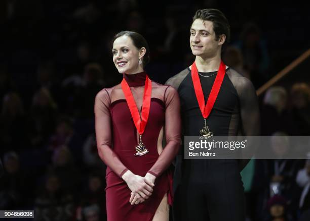 Gold Medalists Tessa Virtue and Scott Moir celebrate winning the senior pair ice dance during the 2018 Canadian Tire National Skating Championships...