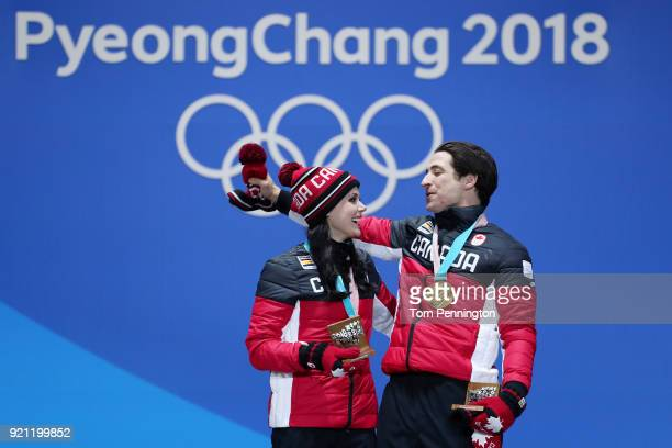 Gold medalists Tessa Virtue and Scott Moir of Canada celebrate during the medal ceremony for Figure Skating Ice Dance Free Dance on day 11 of the...