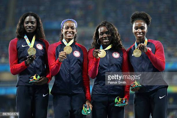Gold medalists Tianna Bartoletta Allyson Felix English Gardner and Tori Bowie of the United States stand on the podium during the medal ceremony for...