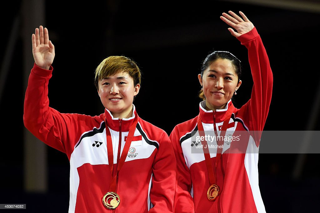 Gold medalists Tianwei Feng and Mengyu Yu of Singapore pose during the medal ceremony for the Women's Doubles Final at Scotstoun Sports Campus during day ten of the Glasgow 2014 Commonwealth Games on August 2, 2014 in Glasgow, Scotland.
