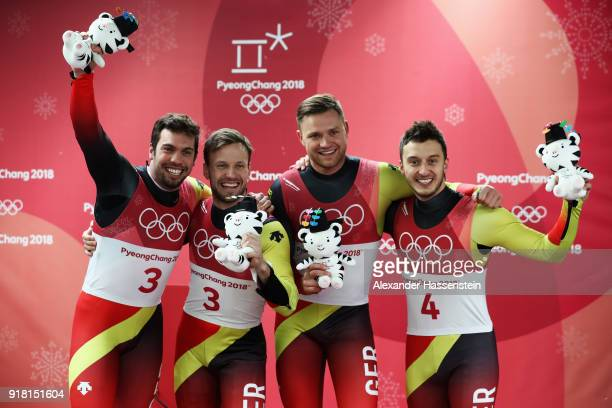 Gold medalists Tobias Wendl and Tobias Arlt of Germany and bronze medalists Toni Eggert and Sascha Benecken of Germany celebrate during the victory...