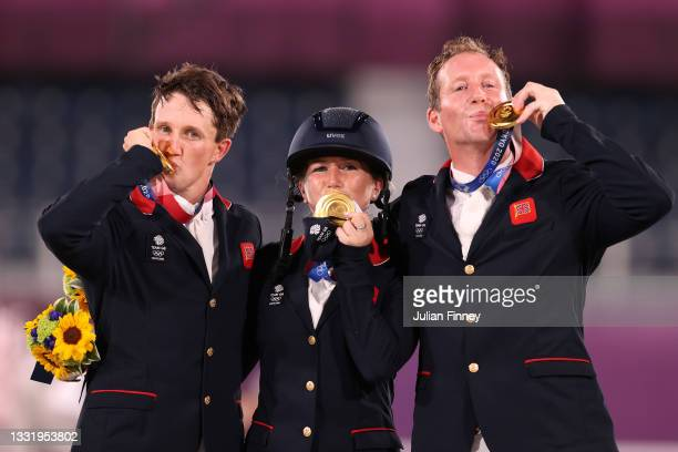 Gold medalists Tom McEwen, Laura Collett and Oliver Townend of Team Great Britain pose with their gold medals during the Eventing Jumping Team medal...