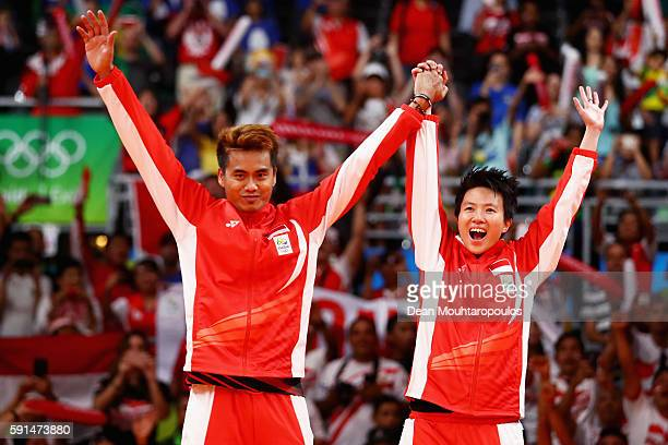 Gold medalists Tontowi Ahmad and Liliyana Natsir of Indonesia celebrates winning the Mixed Doubles Gold Medal Match against Peng Soon Chan and Liu...