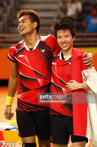 Gold medalists Tontowi Ahmad and Liliyana Natsir of Indonesia celebrate winning the Mixed Doubles Gold Medal Match against Peng Soon Chan and Liu...