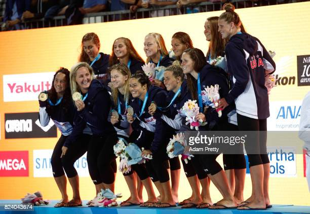 Gold medalists United States celebrate during the medal ceremony for the Women's Water Polo on day fifteen of the Budapest 2017 FINA World...