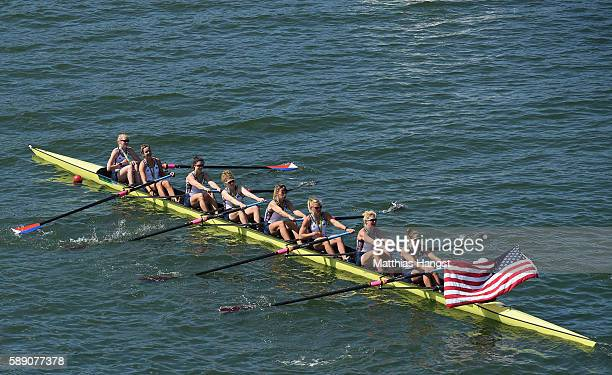 Gold medalists United States celebrate on their boat after the medal ceremony for the Women's Eight on Day 8 of the Rio 2016 Olympic Games at the...