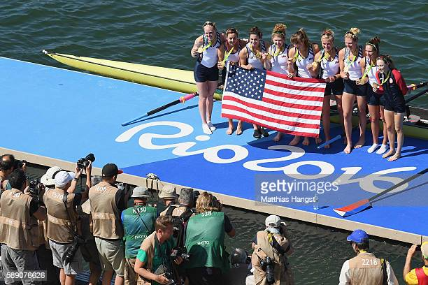 Gold medalists United States pose for photographs after the medal ceremony for the Women's Eight on Day 8 of the Rio 2016 Olympic Games at the Lagoa...