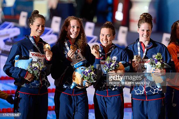 Gold medalists US swimmer Missy Franklin US swimmer Natalie Coughlin US swimmer Shannon Vreeland and US swimmer Megan Romano celebrate on the podium...
