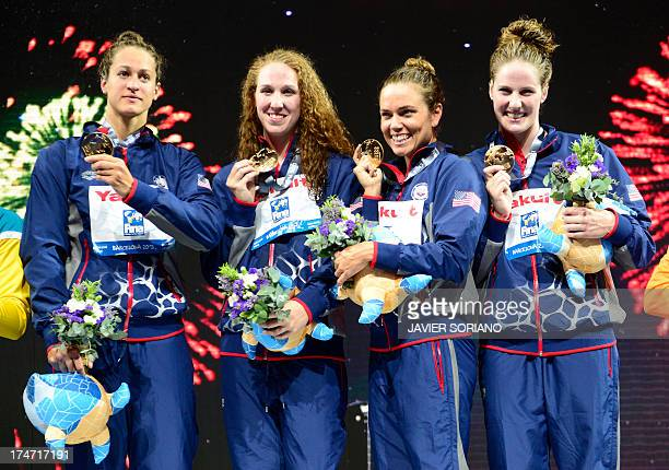 Gold medalists US swimmers Missy Franklin Natalie Coughlin Shannon Vreeland and Megan Romano celebrate on the podium during the award ceremony of the...