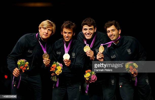Gold medalists Valerio Aspromonte Andrea Baldini Andrea Cassara and Giorgio Avola of Italy celebrate on the podium during the medal ceremony after...