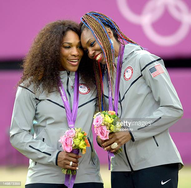 Gold medalists Venus Williams and Serena Williams of the United States celebrate during the medal ceremony for the Women's Doubles Tennis on Day 9 of...