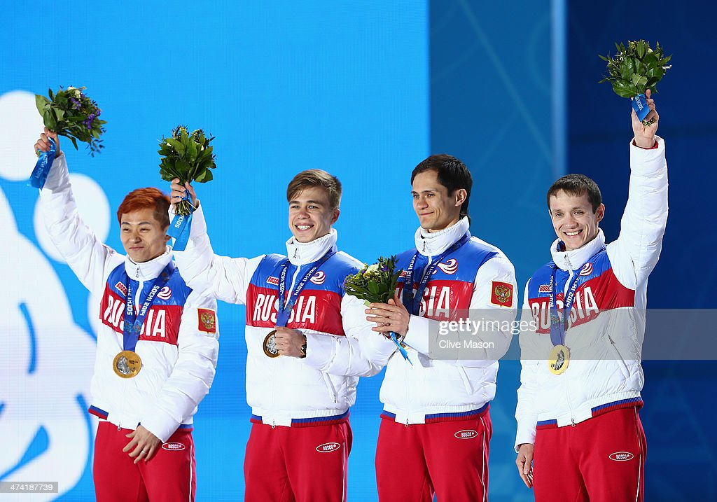 Gold medalists Victor An, Semen Elistratov, Vladimir Grigorev and Ruslan Zakharov of Russia celebrate on the podium during the medal ceremony for the Men's 5000m Relay on Day 15 of the Sochi 2014 Winter Olympics at Medals Plaza on February 22, 2014 in Sochi, Russia.