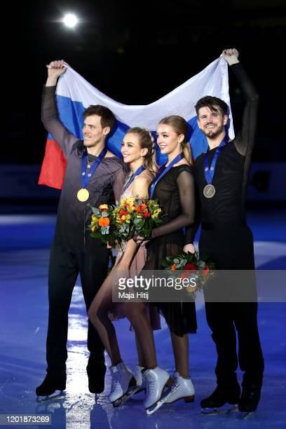 Gold medalists Victoria Sinitsina and Nikita Katsalapov and bronze medalists Alexandra Stepanova and Ivan Bukin of Russia pose for a photo after the...
