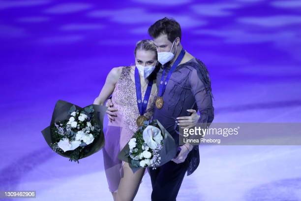 Gold medalists Victoria Sinitsina and Nikita Katsalapov of Figure Skating Federation of Russia celebrate during the medal ceremony for Ice Dance...