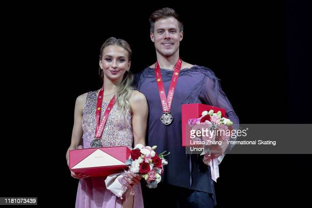 Gold medalists Victoria Sinitsina and Nikita Katsalapov of Russia celebrate during the victory ceremony of the Ice Dance-Free Dance during the ISU...