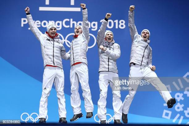 Gold medalists Vinzenz Geiger Fabian Riessle Eric Frenzel and Johannes Rydzek of Germany celebrate during the medal ceremony for Nordic Combined Team...