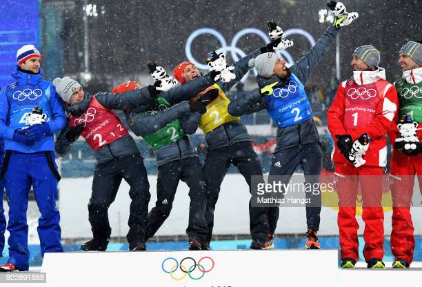 Gold medalists Vinzenz Geiger of Germany Fabian Riessle of Germany Eric Frenzel of Germany and Johannes Rydzek of Germany celebrate during the...