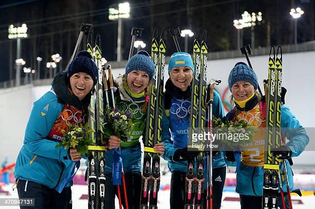 Gold medalists Vita Semerenko Juliya Dzhyma Olena Pidhrushna and Valj Semerenko of Ukraine celebrate during the flower ceremony for the Biathlon...