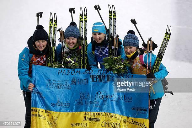 Gold medalists Vita Semerenko Juliya Dzhyma Olena Pidhrushna and Valj Semerenko of Ukraine celebrate after the flower ceremony for the Biathlon...