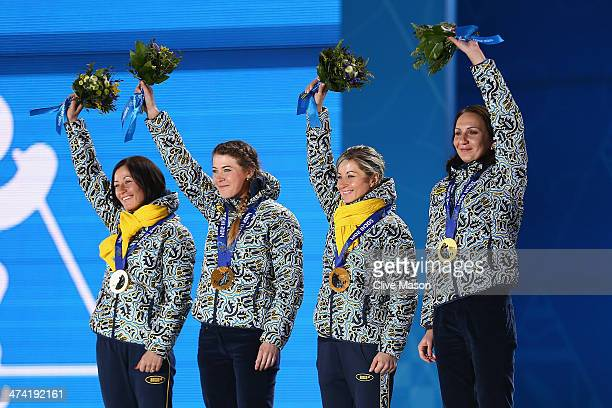 Gold medalists Vita Semerenko Juliya Dzhyma Valj Semerenko and Olena Pidhrushna of Ukraine celebrate during the medal ceremony for the Biathlon...