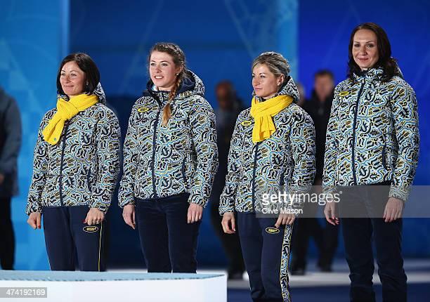Gold medalists Vita Semerenko Juliya Dzhyma Valj Semerenko and Olena Pidhrushna of Ukraine celebrate during the medal ceremony for the Biathlon...