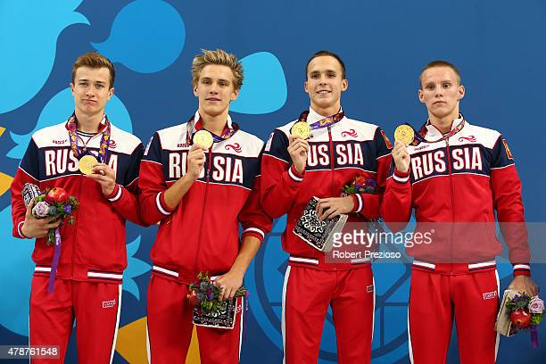 Gold medalists Vladislav Kozlov Daniil Pakhomov Anton Chupkov and Filipp Shopin of Russia pose with the medals won in the Men's 4 x 100m Medley Relay...