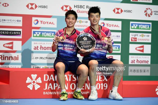 Gold medalists Wang Yi Lyu and Huang Dong Ping of China pose during the medal ceremony of the Mixed Doubles Final match after defeating Praveen...