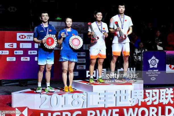Gold medalists Wang Yilyu and Huang Dongping of China and silver medalists Zheng Siwei and Huang Yaqiong of China pose during award ceremony for...