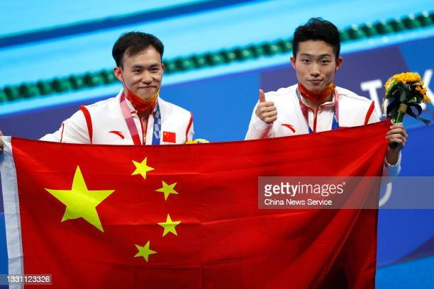 Gold medalists Wang Zongyuan and Xie Siyi of China celebrate during the medal ceremony for the Men's Synchronised 3m Springboard Final on day five of...